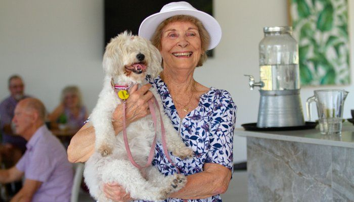 women with pet at retirement living community